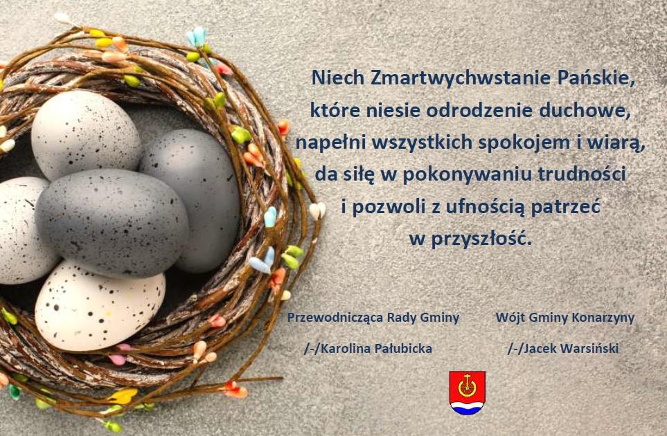 Grafika przedstawia wianek wierzbowy z umieszczonymi w środku szarymi pisankami. Po prawej stronie zamieszczono życzenia z okazji Świąt Wielkanocnych, które składa Przewodnicząca Rady Gminy Karolina Pałubicka oraz Wójt Gminy Konarzyny Jacek Warsiński